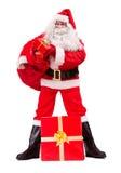 Santa Claus give Christmas gifts stock photos