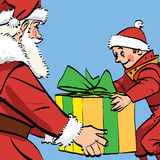 Santa Claus gives the boy a box of gifts Royalty Free Stock Photography