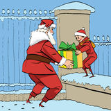 Santa Claus gives the boy a box of gifts Stock Photography