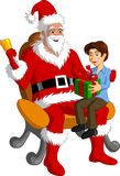 Santa Claus gives boy with gift Stock Images
