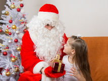 Santa Claus gives gift a five-year girl Royalty Free Stock Photos