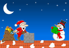 Santa claus gives a gift to a snowman at christmas Royalty Free Stock Photography