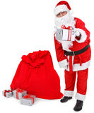 Santa claus gives a present Stock Photo