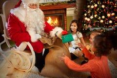 Santa Claus gives presents Royalty Free Stock Image