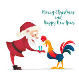 Santa Claus gives presents rooster. Christmas vector illustration. The symbol of the new year 2017. Cartoon characters Royalty Free Stock Images