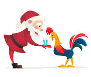 Santa Claus gives presents rooster. Christmas vector illustration. The symbol of the new year 2017. Cartoon characters.  Royalty Free Stock Photo