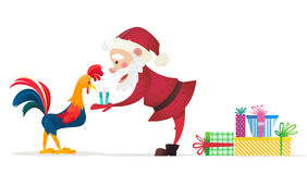 Santa Claus gives presents rooster. Christmas vector illustration. The symbol of the new year 2017. Cartoon characters Stock Photography