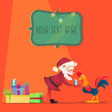 Santa Claus gives presents rooster. Christmas vector illustration. The symbol of the new year 2017. Cartoon characters.  Stock Photography