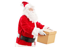 Santa Claus giving a box to someone Stock Image