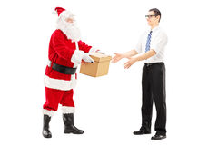 Santa Claus giving a box to a young male Stock Photography
