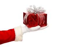Santa claus giving  christmas present box on a Stock Photography