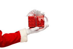 Santa claus giving  christmas present box on a Royalty Free Stock Photography