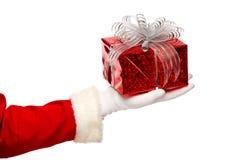 Santa claus giving  christmas present box on a Stock Photos