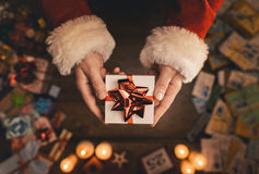 Santa Claus giving a Christmas present Stock Images