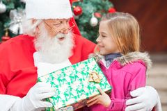 Santa Claus Giving Christmas Present To Girl Royalty Free Stock Images