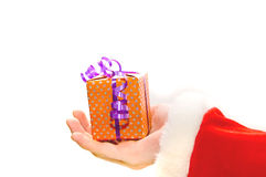 Santa Claus giving a Christmas presents. Stock Image