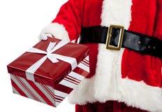 Santa Claus giving Christmas presents stock images