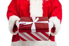 Santa Claus giving Christmas presents stock photos