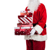 Santa Claus giving Christmas presents royalty free stock photos