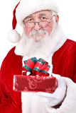 Santa Claus giving gift Stock Images