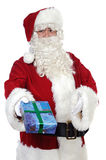 Santa Claus giving a gift Royalty Free Stock Image