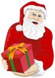 Santa Claus giving a gift Royalty Free Stock Photos