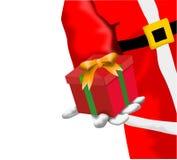 Santa Claus giving a gift Royalty Free Stock Photo