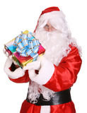 Santa Claus giving gift box . Stock Photo
