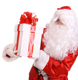 Santa Claus giving gift box with red bow. Stock Photo