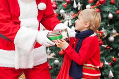 Santa Claus Giving Gift To Boy Stock Photo