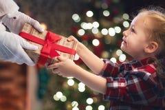 Santa Claus giving gift to child stock photos