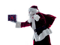 Santa claus giving gifts silhouette isolated Stock Photo