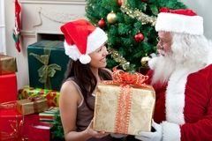 Santa Claus giving a present Royalty Free Stock Photos