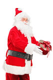 Santa Claus giving a present Stock Images
