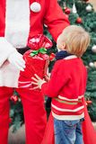 Santa Claus Giving Present To Boy Royalty Free Stock Photo
