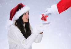 Santa Claus Giving Present to Girl Stock Photos
