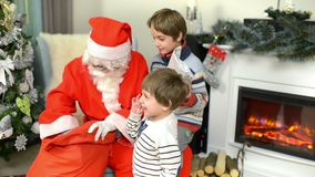 Santa Claus Giving Presents to Children stock video