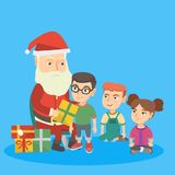 Santa claus giving presents to a group of kids. Stock Image