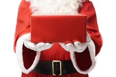 Santa Claus giving some presents to you. Santa Claus giving some presents on white background. Detail photo stock images
