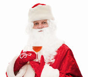 Santa Claus with a glass in hand Royalty Free Stock Images