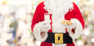 Santa claus with glass of milk and cookies Royalty Free Stock Photos