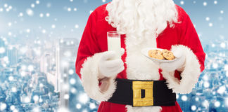Santa claus with glass of milk and cookies Stock Images
