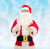 Santa claus with glass of milk and cookies Royalty Free Stock Photo