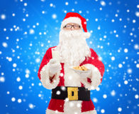 Santa claus with glass of milk and cookies Royalty Free Stock Images