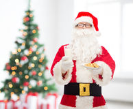 Santa claus with glass of milk and cookies Royalty Free Stock Image