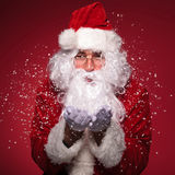 Santa Claus with glasses  blowing snow Stock Photo