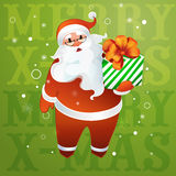Santa Claus in glasses with a gift in their hands Stock Photography