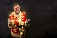Santa Claus with glowing garlands. Santa Claus with glowing garlands and glasses on Christmas on a background of copyspase Royalty Free Stock Photography