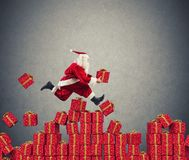 Santa Claus goes fast over Christmas gift. Santa Claus goes fast over the piles Christmas gift stock photo
