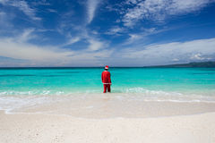 Santa Claus Goes In The Ocean Royalty Free Stock Photos